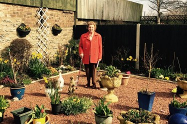 Mary Smith in her garden